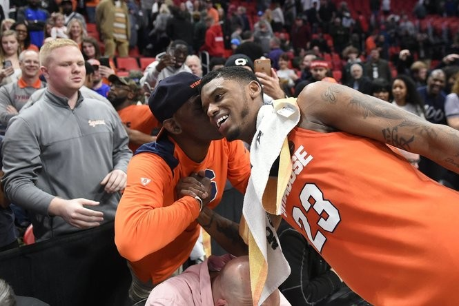 Syracuse guard Frank Howard (23) gets a kiss from his father after the NCAA Tournament second-round game against Michigan State on Sunday, March 18, 2018, at Little Caesars Arena in Detroit. Dennis Nett | dnett@syracuse.com SYR