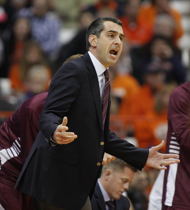 Colgate head coach Matt Langel calls out to his players in the first half of an NCAA college basketball game against Syracuse in Syracuse, N.Y., Friday, Nov. 11, 2016. (AP Photo/Nick Lisi)