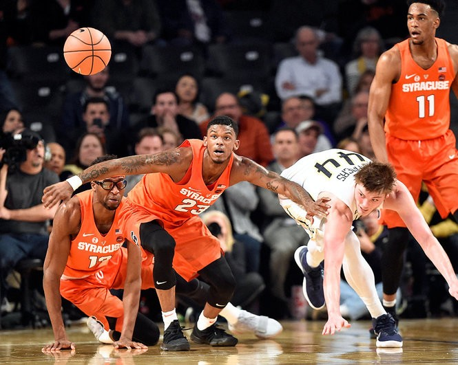 Syracuse guard Frank Howard (23) chases down a loose ball during a game against Georgia Tech on Wednesday, Jan. 31, 2018, at McCamish Pavilion in Atlanta.