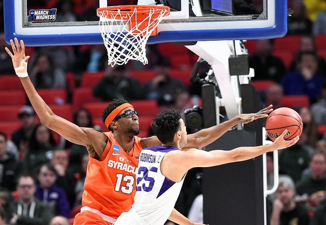 Syracuse center Paschal Chukwu (13) challenges a shot during an NCAA Tournament first-round game against TCU on Friday, March 16, 2018, at Little Caesars Arena in Detroit. Dennis Nett | dnett@syracuse.com SYR