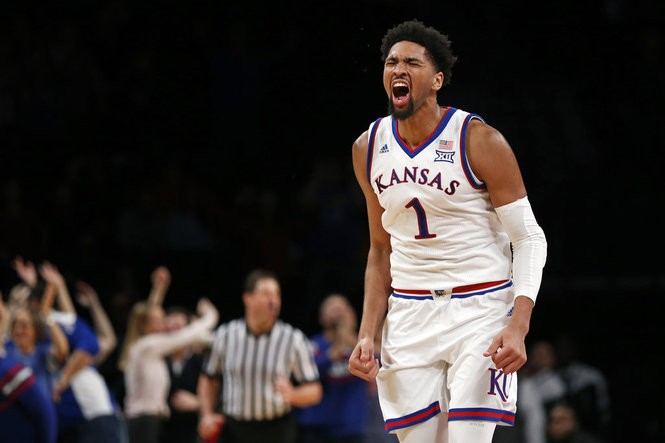 Kansas forward Dedric Lawson reacts after scoring a basket during overtime of the team's NCAA college basketball game against Tennessee in the NIT Season Tip-Off tournament Friday, Nov. 23, 2018, in New York. Kansas defeated Tennessee 87-81. (AP Photo/Adam Hunger) AP