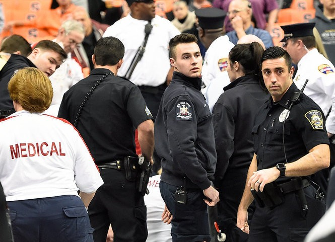 First responders help a fan during a medical emergency before a Syracuse basketball game on Tuesday, Dec. 4, 2018, at the Carrier Dome, in Syracuse, N.Y.