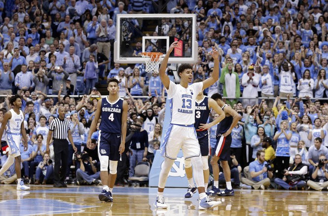 North Carolina's Cameron Johnson (13) reacts following a play while Gonzaga's Greg Foster Jr. (4) walks away during the second half of an NCAA college basketball game in Chapel Hill, N.C., Saturday, Dec. 15, 2018. North Carolina won 103-90. (AP Photo/Gerry Broome) AP
