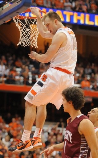 Syracuse's Trevor Cooney finishes on the dunk in the second half vs. Colgate last December.