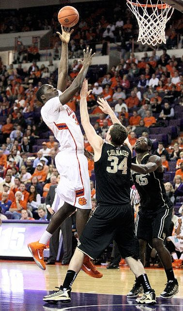 Wake Forest's Tyler Cavanaugh attempts to defend Clemson's Landry Nnoko during Tuesday's game at Clemson, S.C.