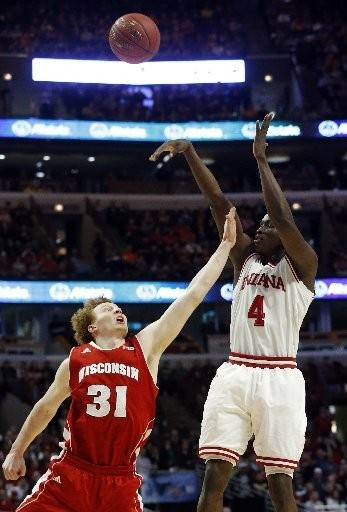 Indiana's Victor Oladipo shoots over Wisconsin's Mike Bruesewitz (31) during the first half of an NCAA college basketball game at the Big Ten tournament Saturday, March 16, 2013, in Chicago.