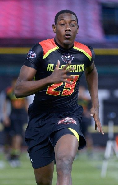 Alin Edouard, who has committed to playing football at Syracuse, runs in a drill during the Under Armour Junior Combine high school football event in St. Petersburg, Fla., earlier this year.