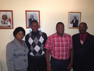 Four of the five members of the Edouard family pose for a photo after celebrating their church's birthday. From left to right, Jocelyne, Alin, Adlin and Edlin.