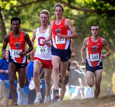 Coach Chris Fox said he'd rank his top three runners, from left, Justyn Knight; Martin Hehir, center, and Colin Bennie, far right, against any team in the nation.