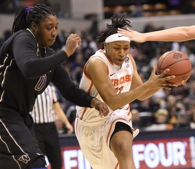 Syracuse University's 5-8 guard Cornelia Fondren (11) drives on Washington's 6-2 forward Chantel Osahor in a NCAA Tournament Final Four game Sunday in Indianapolis.