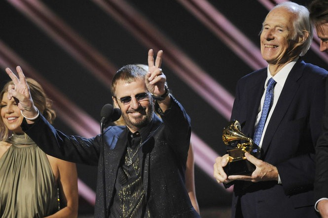 """In this Feb. 10, 2008, file photo, musician Ringo Starr, center, and Beatles producer Sir George Martin accept the best compilation soundtrack album award for """"Love"""" during the 50th annual Grammy awards held at the Staples Center in Los Angeles."""