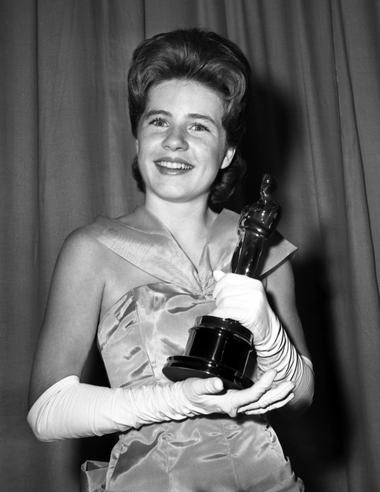 "In this April 8, 1963 file photo, Patty Duke, named best supporting actress of the year for her role in ""The Miracle Worker,"" poses with her award after the Academy Award ceremony in Santa Monica, Calif."