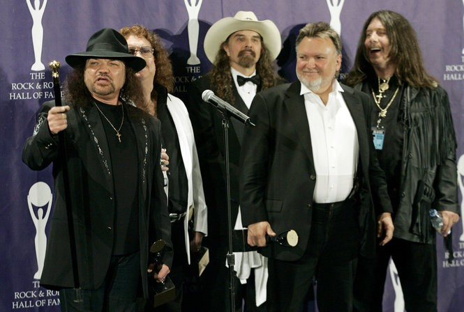 The band Lynyrd Skynyrd, from left to right, Gary Rossington, Billy Powell, Artimus Pyle, Ed King and Bob Burns, pose for photographers backstage after being inducted at the annual Rock and Roll Hall of Fame dinner in New York, Monday, March 13, 2006.