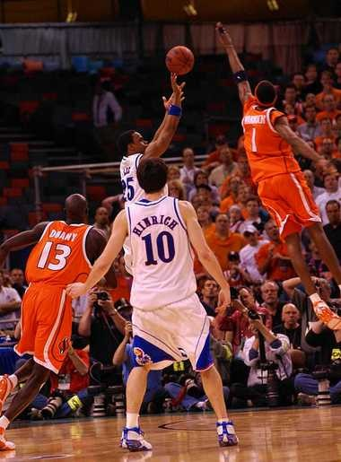 Syracuse forward Hakim Warrick blocks the shot of Kansas guard Michael Lee near the end of the 2003 national championship game.