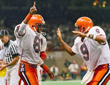 Syracuse's Deval Glover (left) and quarterback Don McPherson celebrate after a touchdown against Auburn in the Sugar Bowl on Jan. 1, 1988 in New Orleans.