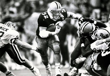 Syracuse fullback Daryl Johnston breaks through Pittsburgh's defensive line in the 4th quarter of a game on Dec. 3, 1988, at the Carrier Dome. Nicholas Lisi | The Post-Standard