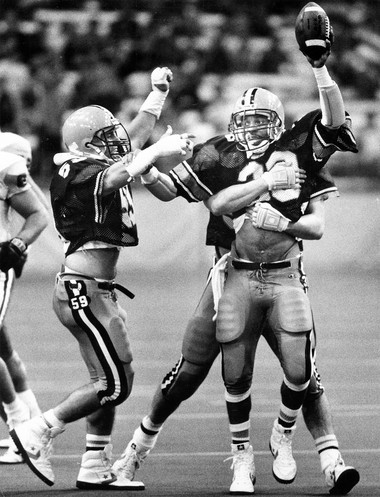 Syracuse defender David Holmes holds up the ball after an interception during a game against Miami (Ohio) on Sept. 19, 1987, at the Carrier Dome. Syracuse won 24-10.