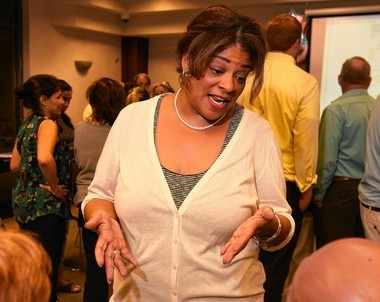 Pam Hunter talks with supporters at a Democratic Party celebration at 250 S. Clinton St., Thursday, September 10, 2015.