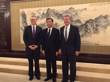 U.S. Deputy Commerce Secretary Bruce Andrews, left, poses with Chinese Vice Premier Wang Yang and U.S. Ambassador to China Max Baucus in Beijing. Andrews visited this week to promote U.S.-China tourism.