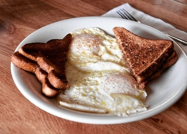 "The ""Dictator Obama/NYS Special (King Cuomo)"" special at the American Diner in Liverpool, N.Y. cost $3.59 plus tax, but the tax is $27.99. The special includes two eggs and toast."