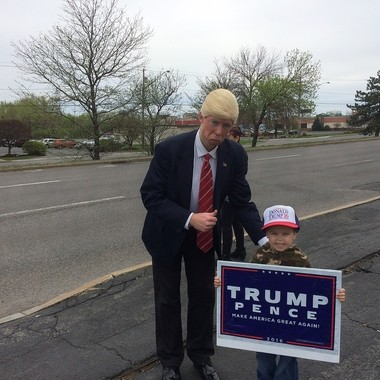 Corey Kinsella dressed up as Donald Trump, and posed alongside Sean Farmer, 4, at the rally for Trump's first 100 days in office in Syracuse.