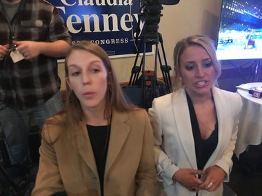 Kate Kelly, left, and another staffer for U.S. Rep. Claudia Tenney speak to the media just after midnight about Tenney staying in the race.