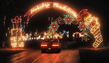 A car passes through a display of Lights on the Lake at Onondaga Lake Park.