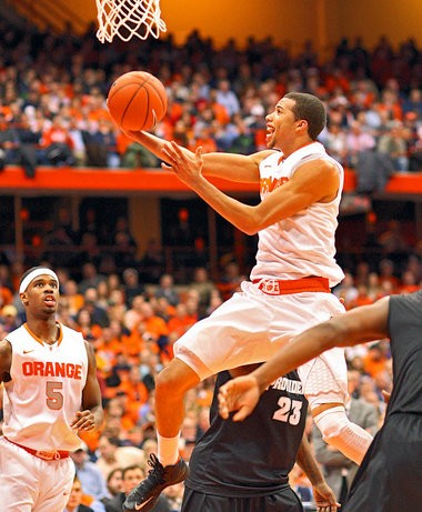 Syracuse guard Michael Carter-Williams goes in for a shot during Wednesday's game against Providence at the Carrier Dome.