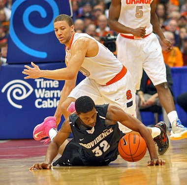 Syracuse guard Brandon Triche and Providence guard Vincent Council dive for a loose ball during Wednesday's game against Providence at the Carrier Dome.