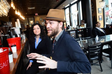Michael John Heagerty, right, and Christi Smith, of NOexcusesSYR are shown at Cafe Kubal.