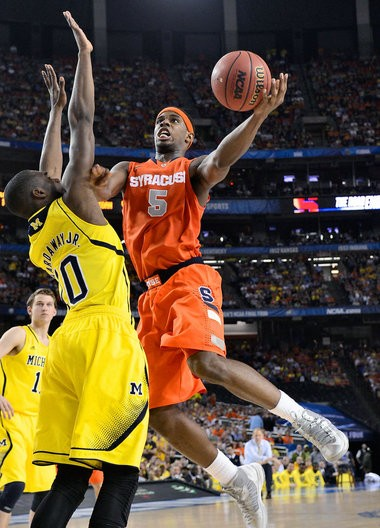 Syracuse forward C.J.Fair is fouled by Michigan's Tim Hardaway Jr. in the second half of the Orange's loss in the Final Four at Atlanta.