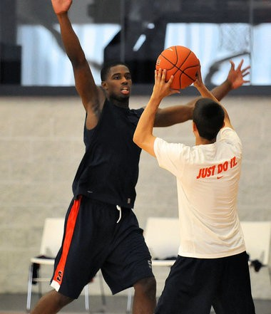 Syracuse senior C.J. Fair works on a defensive drill as the Syracuse University basketball team held its first practice of the season.