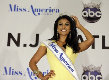 Miss Syracuse 2013 Nina Davuluri poses for photographers after her crowning as Miss America 2014, Sunday, Sept. 15, 2013, in Atlantic City, N.J.