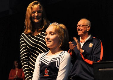 Annie Lown is granted her wish to dance with a prince at the Ms. Orange Fan Luncheon Make-A-Wish Luncheon held at the OnCenter. Jim and Juli Boeheim has the honors of granting Lown her wish. The Orange basketball team were there to sign autographs and to join the patrons in lunch.