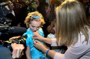 Make-A-Wish kid Annie Lown, 11, arrives at Greystone Castle and receives a Mayor's Pin from Mayor Carla DeShaw before entering the Grand Ball at Greystone Castle in Canastota, N.Y., Friday, Dec. 6, 2013.