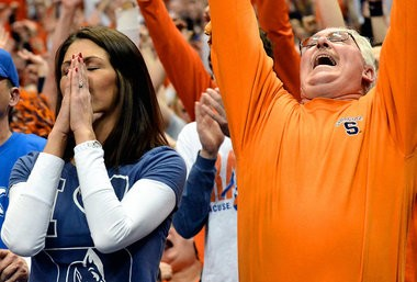 The story of Syracuse fan Michael Younis (right) and Duke fan Leslie Gilman was one of the great subplots to the game on Feb. 1, 2014, at the Carrier Dome. The story took on new life when it was revealed that Gilman and her fiance were ejected from the game.