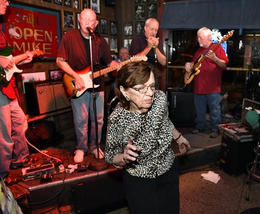 Marge dances to the music from a band at open mic night at Shifty's on Wednesday, July 30, 2014.