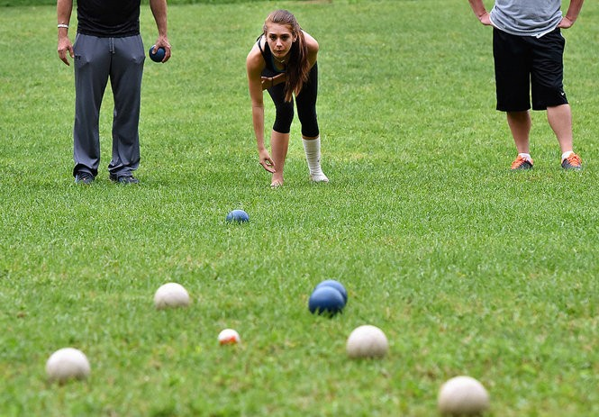 Samantha Ackerman, of Liverpool, plays Turbo Bocce at Sharkey's in Liverpool. Tuesday August 5, 2014. Photo by Gary Walts.