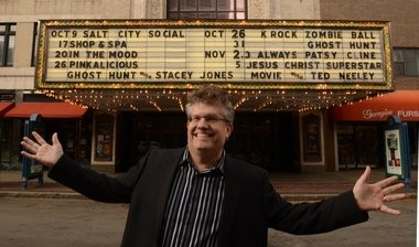 Thomas T. Kazmierczak III, Landmark Theatre Executive Director, poses in front of the downtown theater in 2013.
