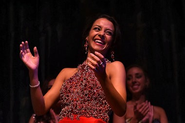 Anneliese Trust reacts after hearing that she will be crowned Miss Syracuse 2015 during the Miss Syracuse Triple Crown competition on November 9, 2014, at the Palace Theater in Syracuse.