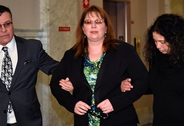 Plaintiff Vicki Calcagno,of Liverpool, arrives for trial Thursday morning, January 15, 2015.