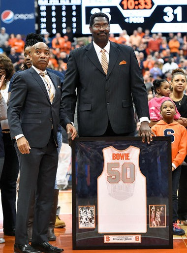 Roosevelt Bouie holds his jersey next to Syracuse athletic director Daryl Gross. Bouie's name was spelled Bowie on the jersey.