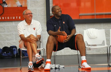 Syracuse head coach Jim Boeheim and former player Derrick Coleman joke around with a player participating in the Jim Boeheim Fantasy Basketball Camp