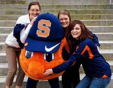 Former Otto the Orange mascots (from left) Julie Walas-Huynh, Shana Segbers and Shannon Feeney Andre pose with a current Otto on the Syracuse University Quad before last week's football game against Pittsburgh. Huynh is currently SU's mascot coach.