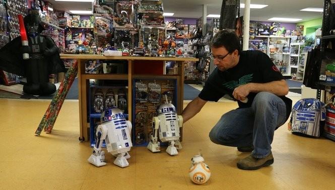 """Star Wars"" super fan Brett Rewakowski owns Living the Dream, a toy shop and art studio at 60 E. Main St. in Marcellus. Photo by Katrina Tulloch."