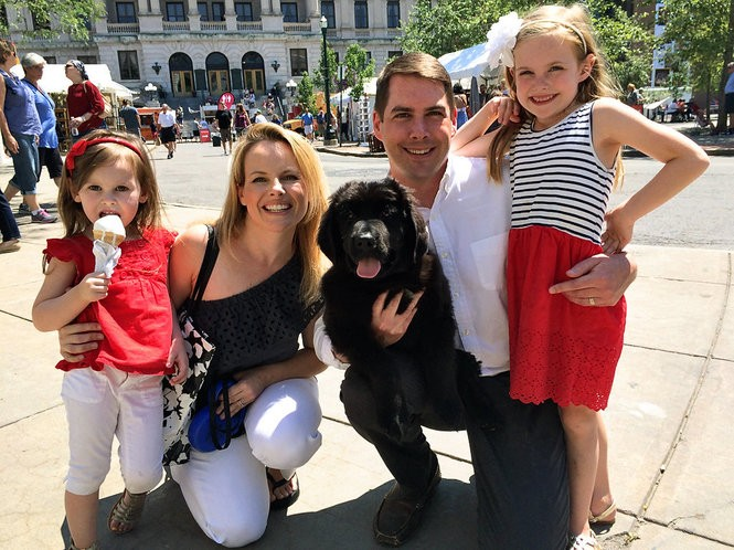 Ben Walsh poses with his family at the Syracuse Arts & Crafts festival near Columbus Circle