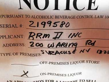 Liquor License Application Sign In The Window At Former ALFA Bar Dining Room