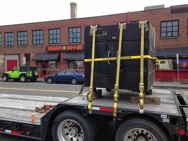 """The original smoker from the original Dinosaur Bar-B-Que in Syracuse, dubbed """"Little Black,"""" loaded onto a truck. It will be retooled for use as a portable smoker for catering."""