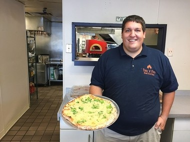 Nick Sanford, owner of Toss 'n Fire pizza shop, 315 N. Main St.(Route 11) in North Syracuse. The shop opened this week and joins Sanford's two mobile wood-fired units operating in Central New York.