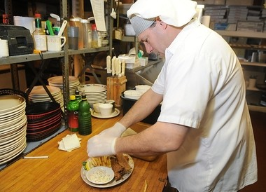 Ed Biel Jr. prepares bullheads at William's Restaurant in this photo from 2010.
